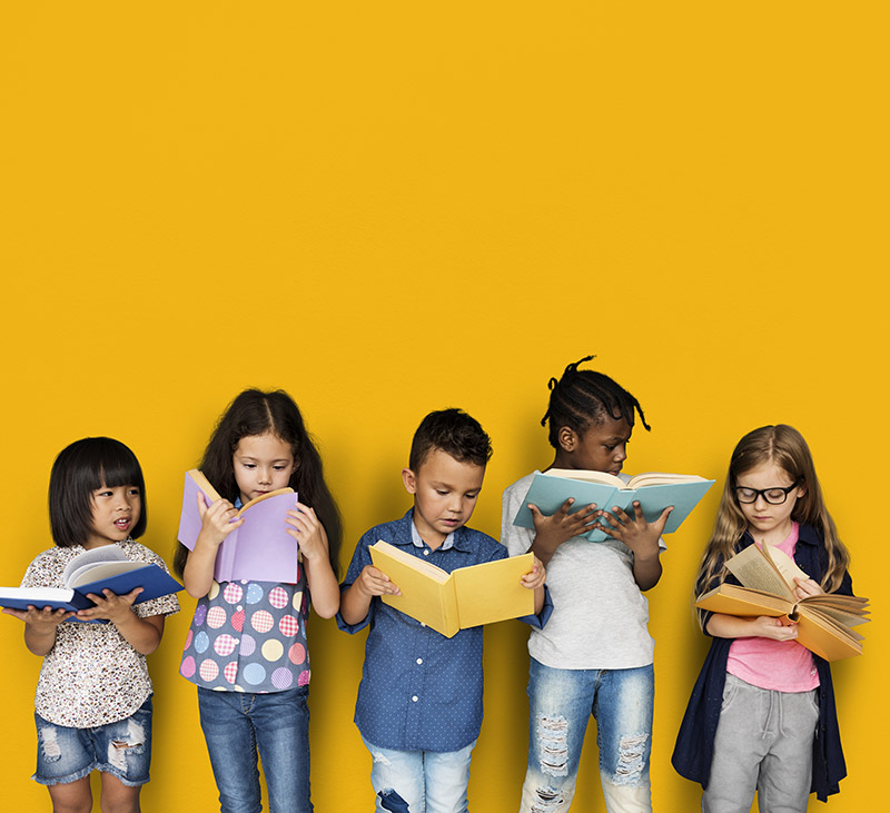 group of preschool students reading books