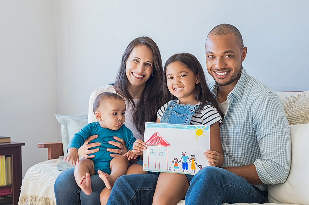 parents with their preschooler and infant